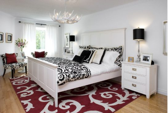 Black and white bedroom with red rug
