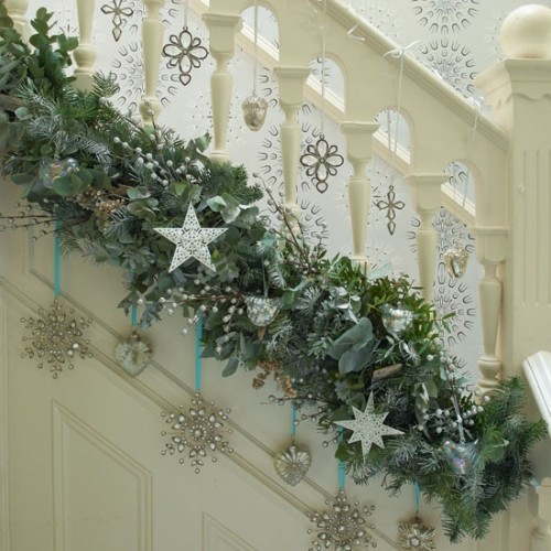 1 drape a garland - Christmas Hallway Decorating Ideas