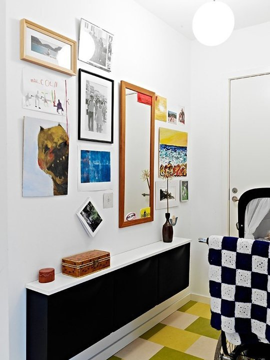 Ikea Malm Attached Nightstand ~ This grouping of three black cabinets combined with a white shelf acts